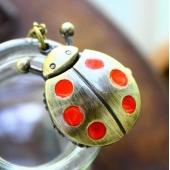 Montre collier coccinelle points rouges